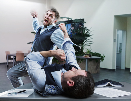 39184919 - two furious businessmen fighting in the office